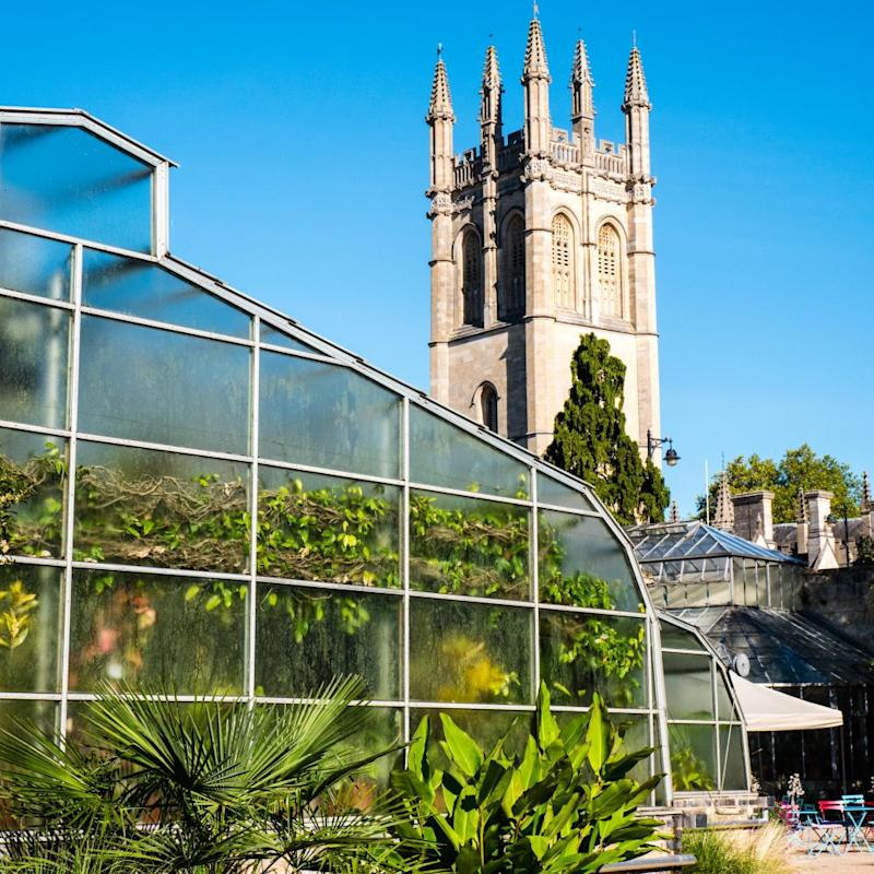 Greenhouse and Magdalen Tower, University of Oxford Botanic Garden, Oxford, Oxfordshire, England, UK.