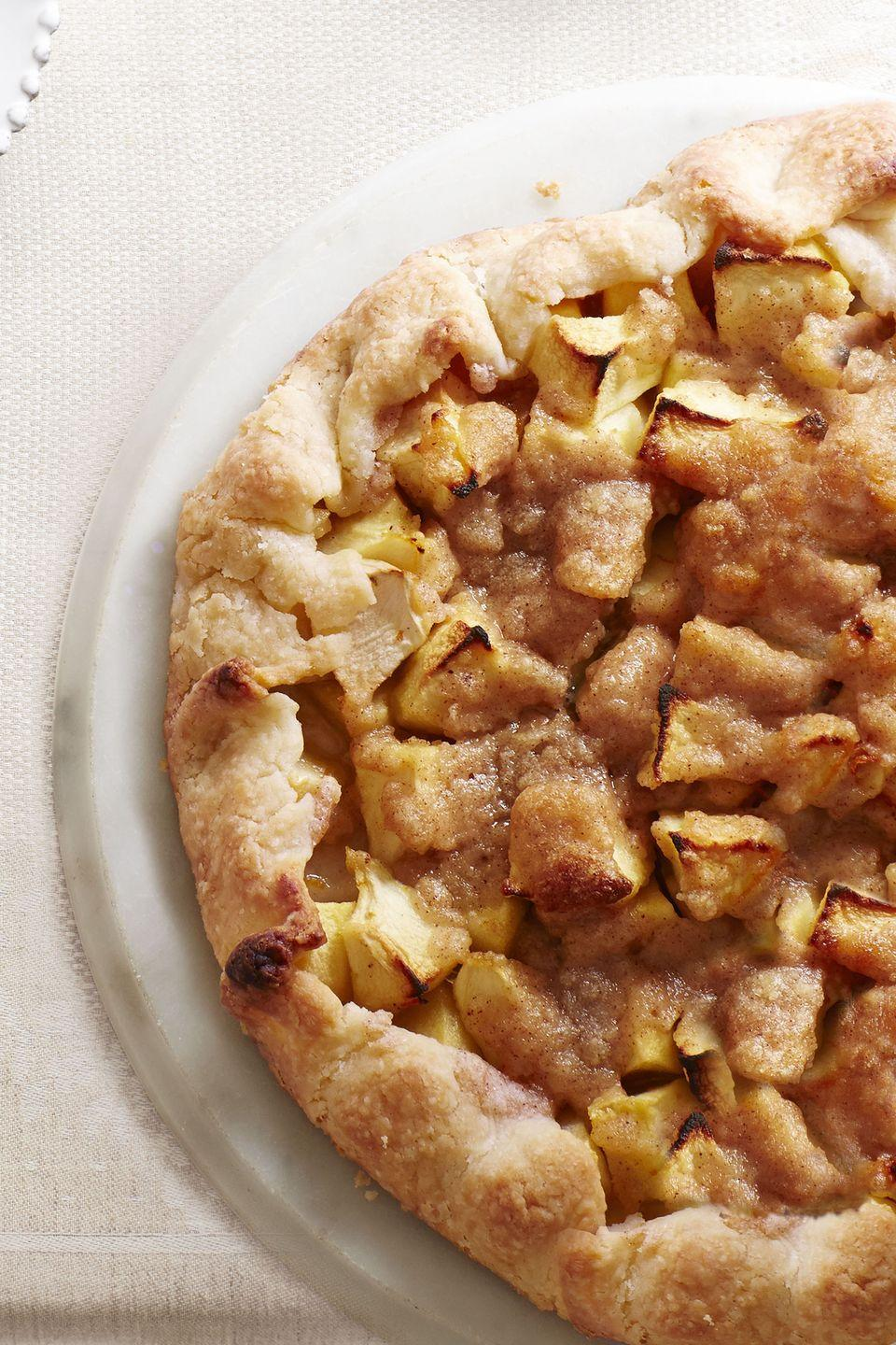 """<p>The dough for this easier, free-form version of apple pie can be made in advance. All you have to do on the big day is roll it out, fill it, and pop it in the oven as you sit down to feast.</p><p><a href=""""https://www.goodhousekeeping.com/food-recipes/a15408/apple-crostata-recipe-ghk1113/"""" rel=""""nofollow noopener"""" target=""""_blank"""" data-ylk=""""slk:Get the recipe for Apple Crostata »"""" class=""""link rapid-noclick-resp""""><em>Get the recipe for Apple Crostata »</em></a></p>"""