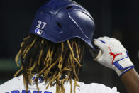 Toronto Blue Jays' Vladimir Guerrero Jr. puts on his batting helmet during the sixth inning of a baseball game against the Baltimore Orioles in Buffalo, N.Y., Thursday, June 24, 2021. (AP Photo/Joshua Bessex)