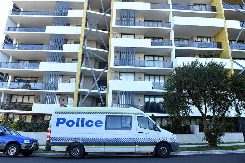 Police vans are seen at a lock downed apartment building at Warby Street in the south western suburb of Campbelltown in Sydney.