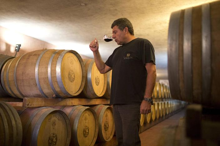 Yoav Levy, owner and winemaker at Bazelet Hagolan Winery, tastes his 2011 Merlot in the winery's cellar in the Israeli-annexed Golan Heights on September 20, 2012 (AFP Photo/Menahem Kahana)