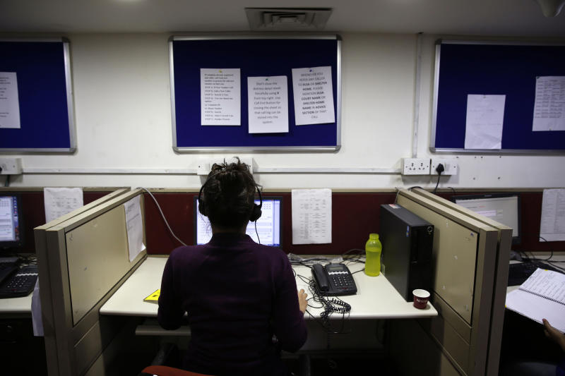In this Monday, Dec. 2, 2013 photo, an Indian woman takes calls on a government hotline established in the wake of last year's gang rape and murder of a young woman, in New Delhi, India. The government hotline is part of a wave of change since the case forced the country to confront its appalling treatment of women. New laws have made stalking, voyeurism and sexual harassment a crime. There is now a fast-track court for rape cases. In some ways, the case cracked a cultural taboo surrounding discussion of sexual violence in a country where rape is often viewed as a woman's personal shame to bear. (AP Photo/Saurabh Das)