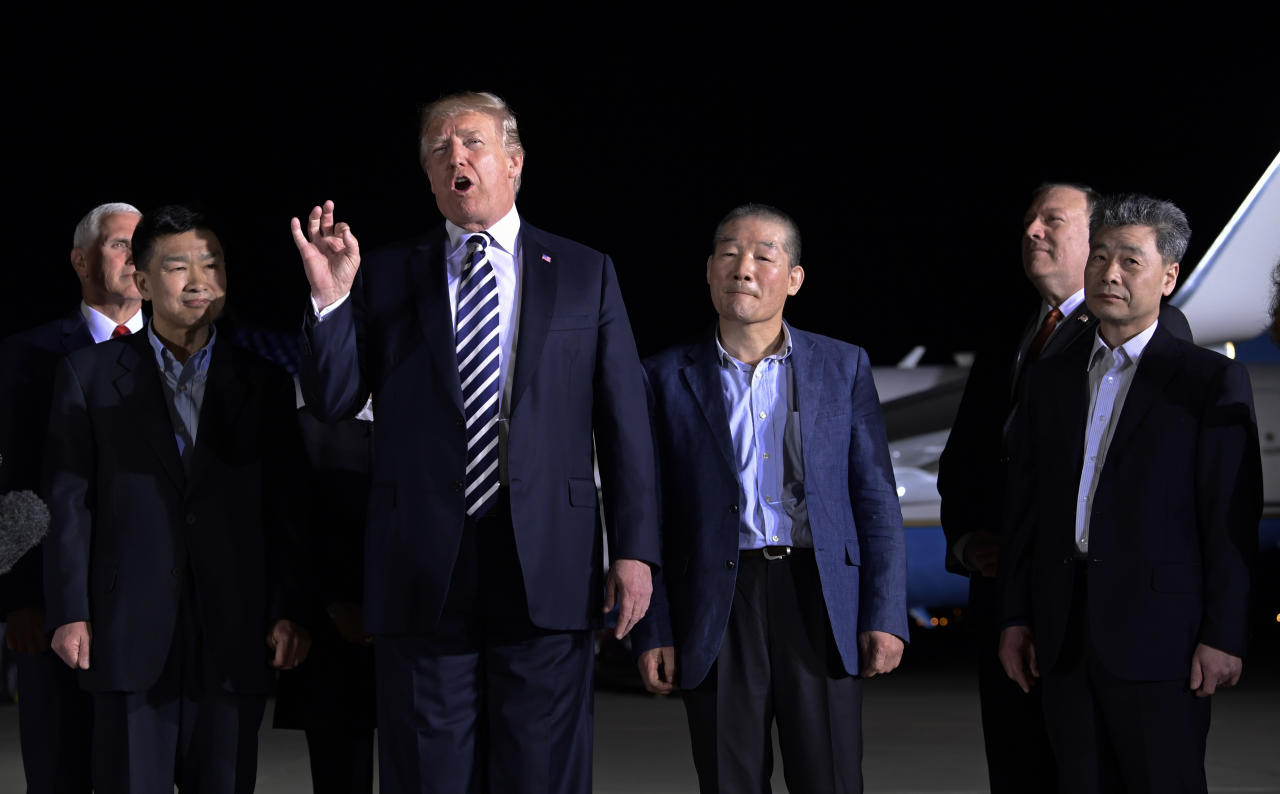 <p>President Donald Trump speaks as he stands with Tony Kim, second left, Kim Dong Chul, center right, and Kim Hak Song, right, three Americans detained in North Korea for more than a year, after they arrived at Andrews Air Force Base in Md., Thursday, May 10, 2018. Vice President Mike Pence, left, and Secretary of State Mike Pompeo, second from right, listen. (Photo: Susan Walsh/AP) </p>