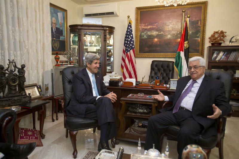 U.S. Secretary of State John Kerry, left, meets with Palestinian President Mahmoud Abbas for the second time in Amman, Jordan, on Saturday, June 29, 2013, after shuttling to Jordan from Jerusalem in the morning. On his fifth trip to the Middle East, Kerry met with Abbas for the second time in two days as he continues a rushed round of shuttle diplomacy to restart talks between Israel and the Palestinians. He plans to fly back to Jerusalem later in the day for more talks with Israeli officials. (AP Photo/Jacquelyn Martin, Pool)