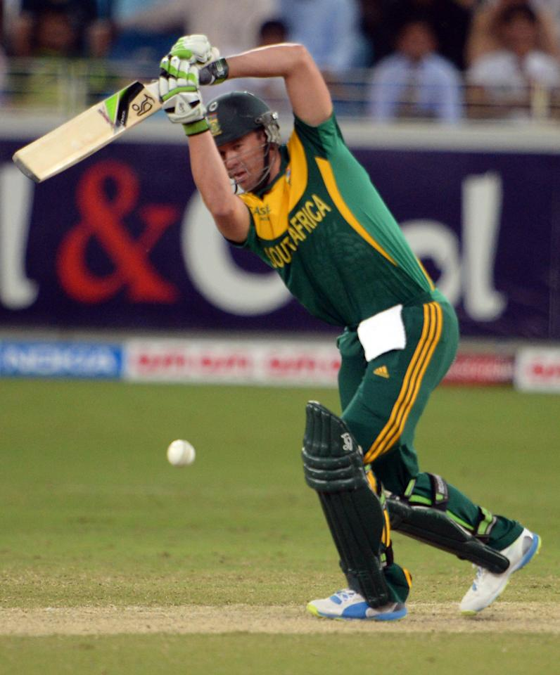 South African captain AB de Villiers plays a shot during the second day-night international against South Africa in Dubai Cricket Stadium in Dubai on November 1, 2013. Pakistan were bowled out for 209 in their innings. South Africa lead the five-match series 1-0. AFP PHOTO/ Asif HASSAN        (Photo credit should read ASIF HASSAN/AFP/Getty Images)