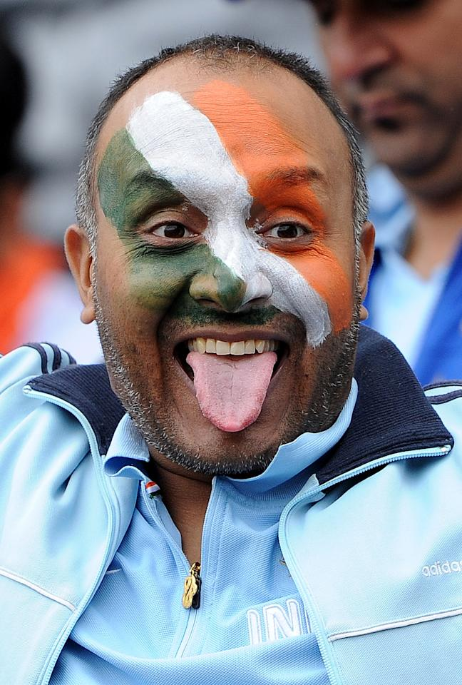 An Indian fan attends the 2013 ICC Champions Trophy cricket match between Pakistan and India at Edgbaston in Birmingham, central England, on June 15, 2013. AFP PHOTO/ANDREW YATES
