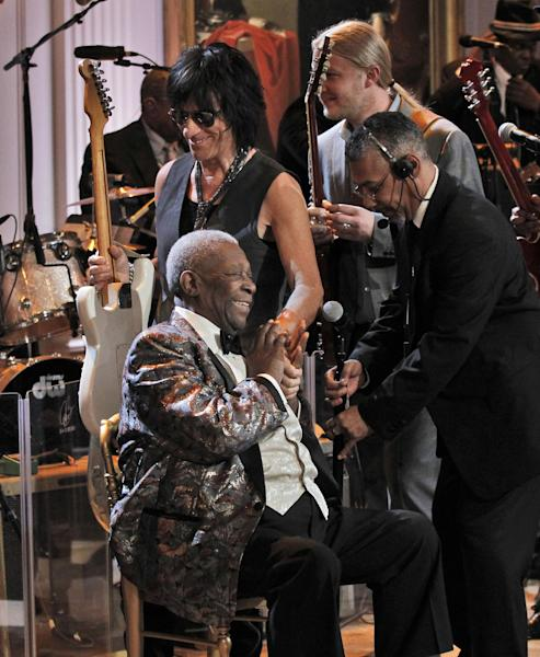 B.B. King, is greeted by Jeff Beck, as they stake the stage to perform during the White House Music Series saluting Blues Music in recognition of Black History Month, Tuesday, Feb. 21, 2012, in the East Room of the White House in Washington. (AP Photo/Pablo Martinez Monsivais)