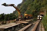 Rescuers work at the site a day after a deadly train derailment at a tunnel north of Hualien