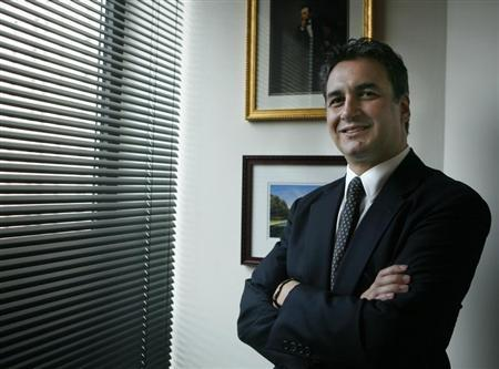 U.S. attorney Michael Garcia poses for a photo in his New York office July 25, 2007. REUTERS/Brendan McDermid