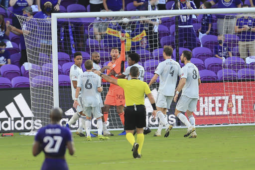New England Revolution goalkeeper Matt Turner (30) celebrates with teammates after making a save on a penalty kick by Orlando City forward Nani (not shown) during the second half of an MLS playoff soccer match, Sunday, Nov. 29, 2020, in Orlando, Fla. (AP Photo/Matt Stamey)