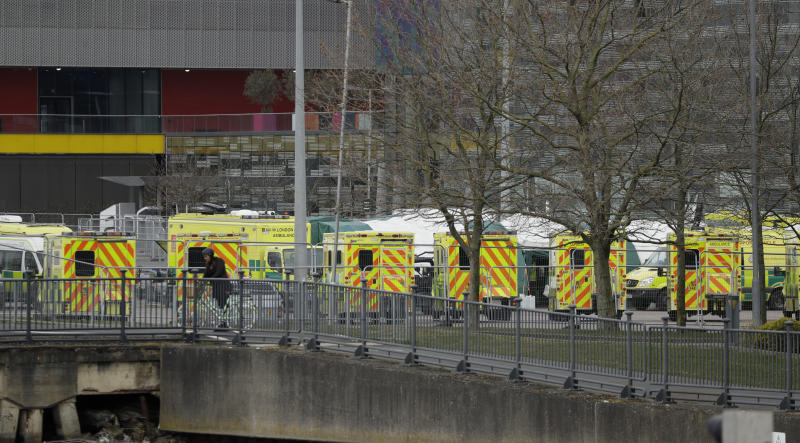 A line of London ambulances outside the ExCel center, which is being turned into a 4000 bed temporary hospital called NHS Nightingale to deal with coronavirus patients in London, Monday, March 30, 2020. The new coronavirus causes mild or moderate symptoms for most people, but for some, especially older adults and people with existing health problems, it can cause more severe illness or death.(AP Photo/Matt Dunham)