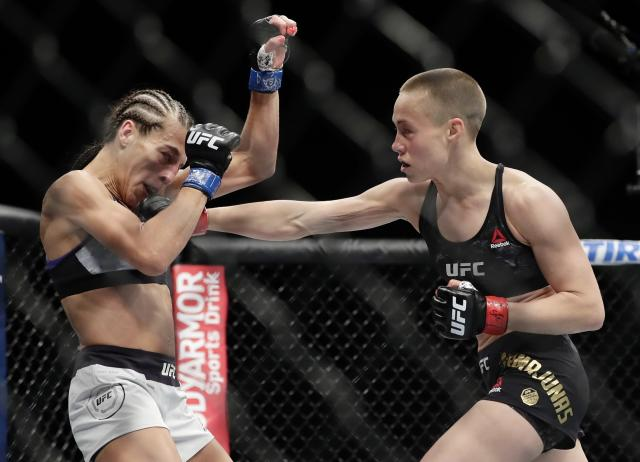 Rose Namajunas (R) punches Poland's Joanna Jedrzejczyk during the first round of a women's strawweight title bout at UFC 223 early Sunday, April 8, 2018, in New York. Namajunas won the fight. (AP Photo/Frank Franklin II)