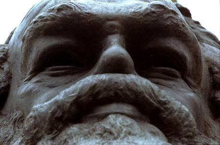 FILE PHOTO: A monument to Karl Marx stands above his remains in Highgate Cemetery, London, February 1998.