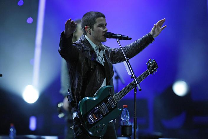 Nick Jonas, member of the band Jonas Brothers, performs at the Vina del Mar International Song Festival in Vina del Mar, Chile, Tuesday, Feb. 26, 2013. Believed to be one of the largest musical events in Latin America, the annual 5-day festival was inaugurated in 1960. (AP Photo/Luis Hidalgo)