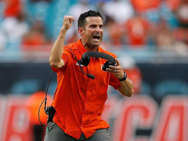<p>Miami head coach Manny Diaz celebrates after a touchdown against Bethune Cookman during the first half at Hard Rock Stadium on Sept. 14, 2019.</p>