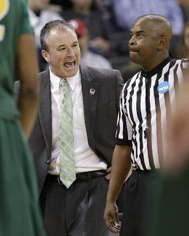 North Dakota State coach Saul Phillips, left, talks with an official in the first half against Oklahoma during the second round of the NCAA men's college basketball tournament, in Spokane, Wash., Thursday, March 20, 2014. (AP Photo/Elaine Thompson)