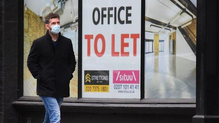 A man walks past an office to let sign in London