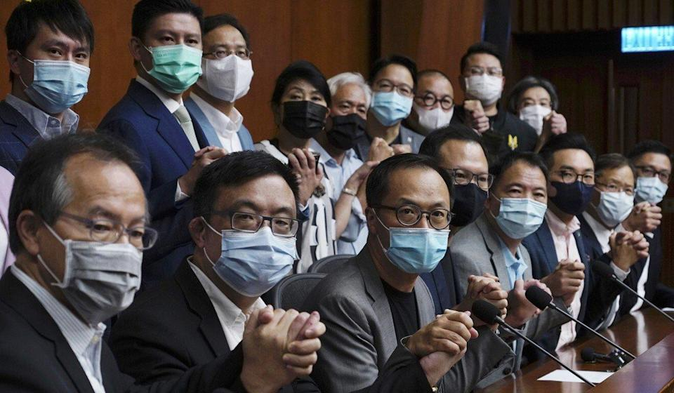 Hong Kong's opposition legislators pose for a picture before a press conference at the Legislative Council on November 9, 2020. Photo: AP