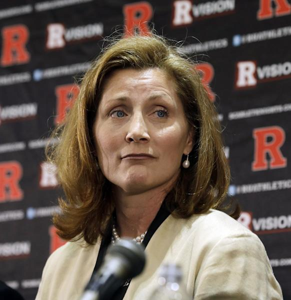 FILE - In this Wednesday, May 15, 2013 file photo, Julie Hermann listens during a news conference where she was introduced as the new athletic director at Rutgers University, in Piscataway, N.J. Hermann, hired to clean up Rutgers' scandal-scarred athletic program, quit as Tennessee's women's volleyball coach 16 years ago after her players submitted a letter complaining she ruled through humiliation, fear and emotional abuse, The Star-Ledger reported Saturday, May 25, 2013, on its website. (AP Photo/Mel Evans, File)