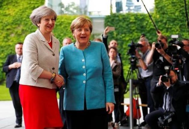 May, Merkel agree citizens' rights must come first in EU talks: Britain