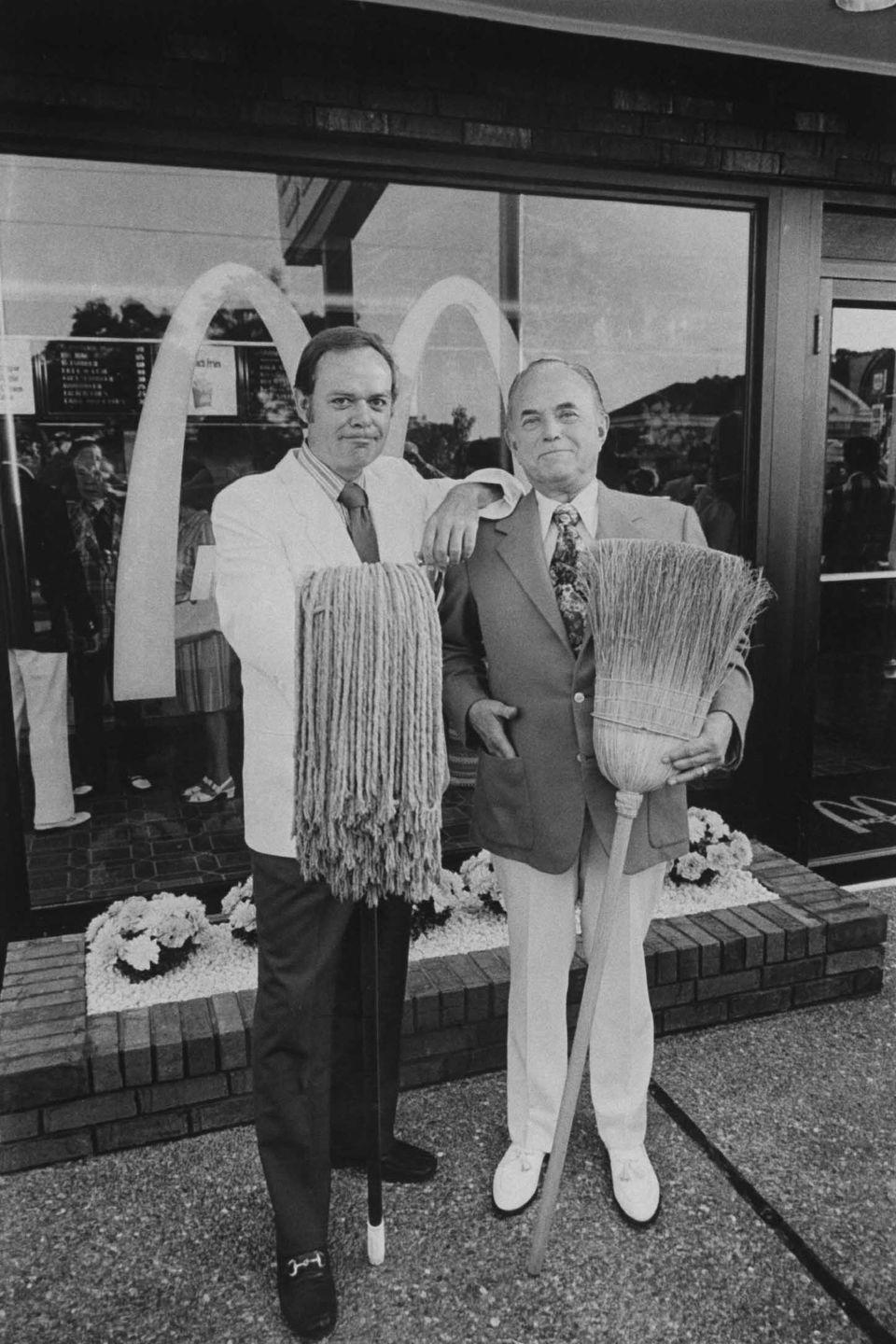 <p>President Frederick Turner and CEO Raymond Kroc posing in celebration of the opening of McDonald's 2,500th location, which was located in a suburban shopping center in Hickory Hills, Illinois. Not sure why they're holding a broom and mop, but OK!</p>