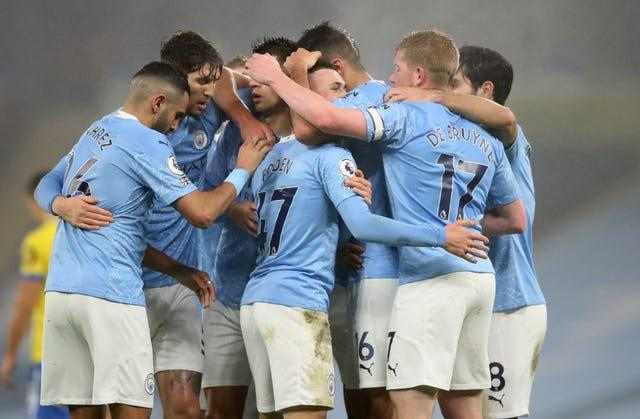 Manchester City players celebrate Phil Foden's goal.