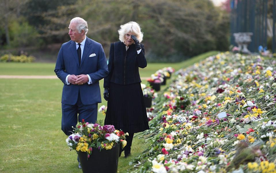 The Prince of Wales and the Duchess of Cornwall visit the gardens of Marlborough House, London, to view the flowers and messages left by members of the public outside Buckingham Palace following the death of the Duke of Edinburgh on April 10 - Jeremy Selwyn