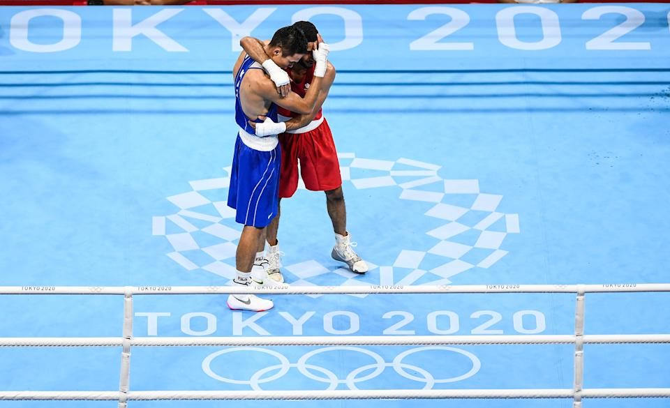 <p>Saken Bibossinov of Kazakhstan, left, and Galal Yafai of Great Britain embrace after their men's flyweight semi-final bout at the Kokugikan Arena during the 2020 Tokyo Summer Olympic Games in Tokyo, Japan. (Photo By Stephen McCarthy/Sportsfile via Getty Images)</p>