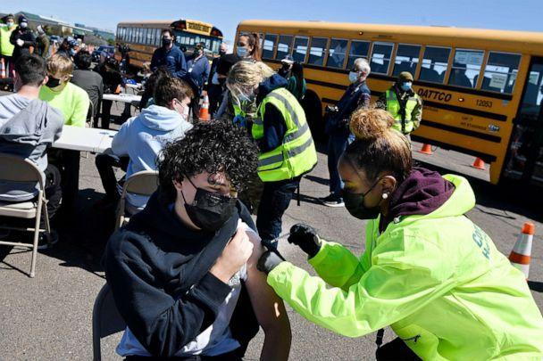 PHOTO: CREC Academy of Aerospace and Engineering sophomore Brian Acevedo, 16, receives a COVID-19 vaccine from nurse Myra Glass, of East Hartford, during a mass vaccination site at Pratt & Whitney Runway in East Hartford, Conn., April 26, 2021. (Jessica Hill/AP, FILE)