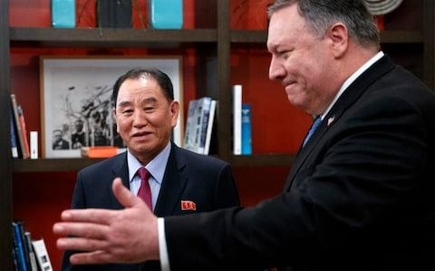 Secretary of State Mike Pompeo, right, and Kim Yong Chol, a North Korean senior ruling party official and former intelligence chief - Credit: AP