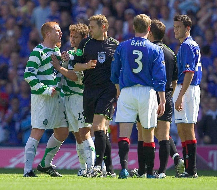 Neil Lennon as a player arguing with a referee, among other Celtic and Rangers players