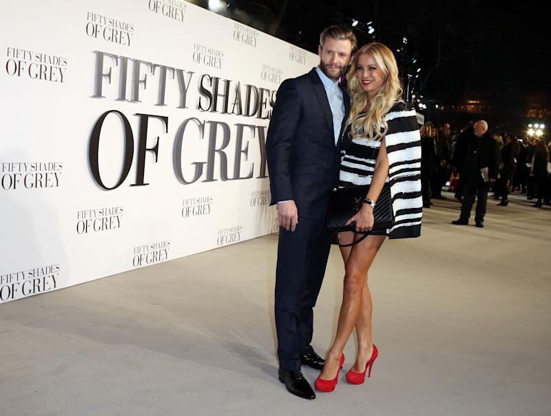 Denise Van Outen and guest pose for photographers upon arrival at the UK premiere of the film 'Fifty Shades of Grey' in London, Thursday, Feb. 12, 2015. (Photo by Joel Ryan/Invision for Universal Pictures/AP Images)