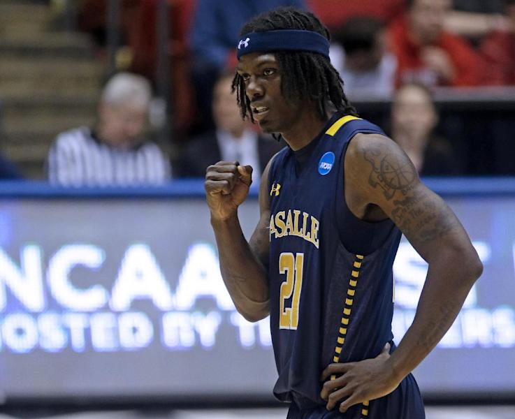 La Salle guard Tyrone Garland (21) pumps his fist after a teammate made a free throw in the closing seconds of a first-round game against Boise State in the NCAA college basketball tournament, Wednesday, March 20, 2013, in Dayton, Ohio. Garland led La Salle to an 80-71 win with 22 points. (AP Photo/Al Behrman)