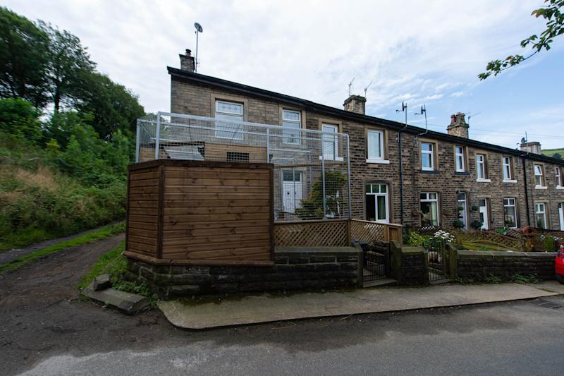 The cage sits at the end of a row of terraced houses in West Yorkshire (Picture: SWNS)