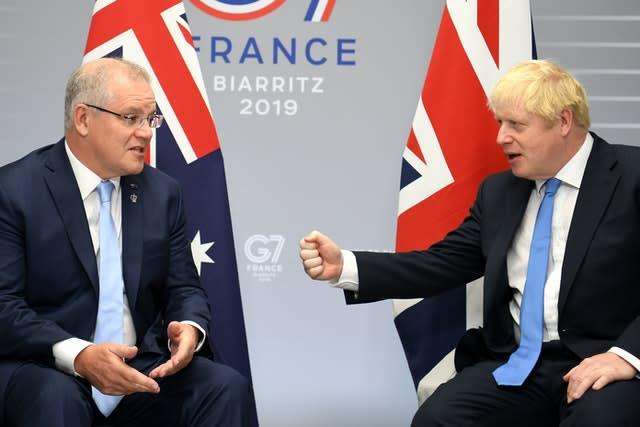 Australian Prime Minister Scott Morrison, left, has suspended his country's extradition treaty with Hong Kong (Neil Hall/PA)