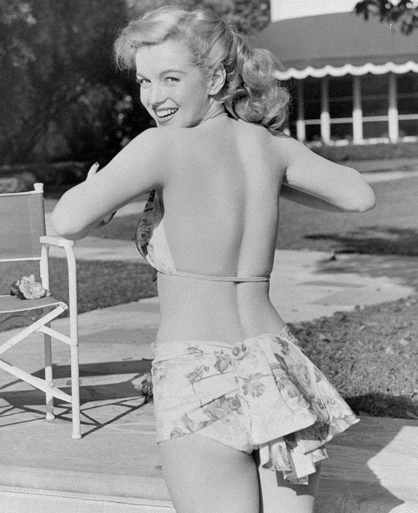 <p>Marilyn began the transformation from all-American charmer to screen siren in this swimsuit shot staged by the studio. </p>