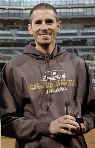 Oakland Athletics pitcher Brandon McCarthy smiles after being named the team's nominee for the Roberto Clemente award, prior to the Athletics' baseball game against the Seattle Mariners on Friday, Sept. 28, 2012, in Oakland, Calif. McCarthy was hit in the head by line drive hit by Los Angeles Angels' Erick Aybar earlier in the month. (AP Photo/Ben Margot)