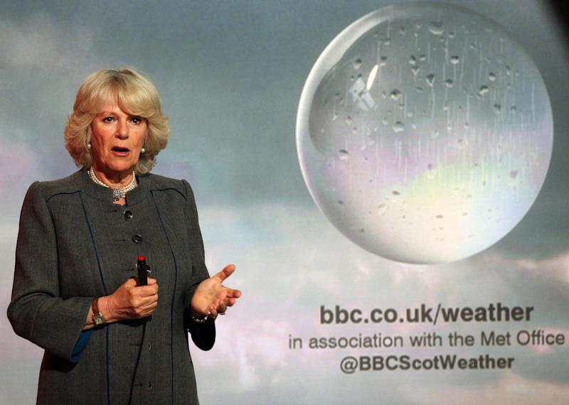 Britain's Camilla, the Duchess of Cornwall reads the weather in the Six O'Clock studio whilst on a tour of the BBC Scotland Headquarters in Glasgow, Scotland where they met staff to celebrate sixty years of BBC Scotland Television Thursday May 10, 2012. (AP Photo/Andrew Milligan/PA Wire) UNITED KINGDOM OUT