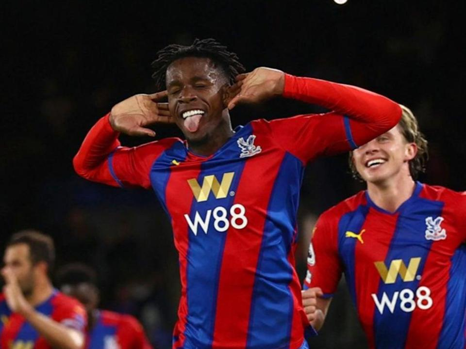 Wilfried Zaha celebrates scoring from the penalty spot (AFP via Getty Images)