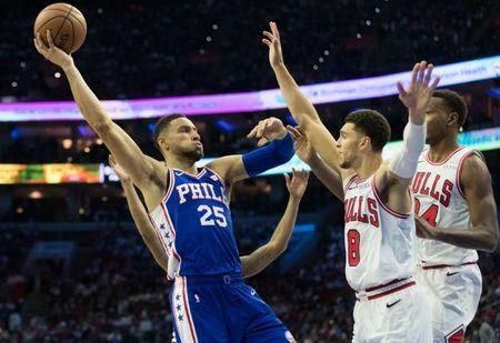 Oct 18, 2018; Philadelphia, PA, USA; Philadelphia 76ers guard Ben Simmons (25) shoot the ball as Chicago Bulls guard Zach LaVine (8) defends during the third quarter at Wells Fargo Center. Mandatory Credit: Bill Streicher-USA TODAY Sports