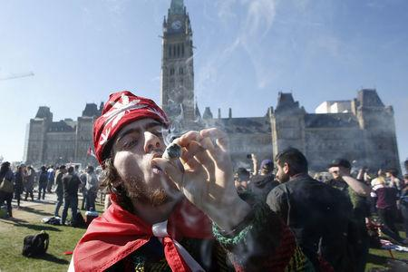 FILE PHOTO: A man smokes marijuana during an annual 4/20 rally on Parliament Hill in Ottawa, Canada, April 20, 2016. REUTERS/Chris Wattie/File Photo