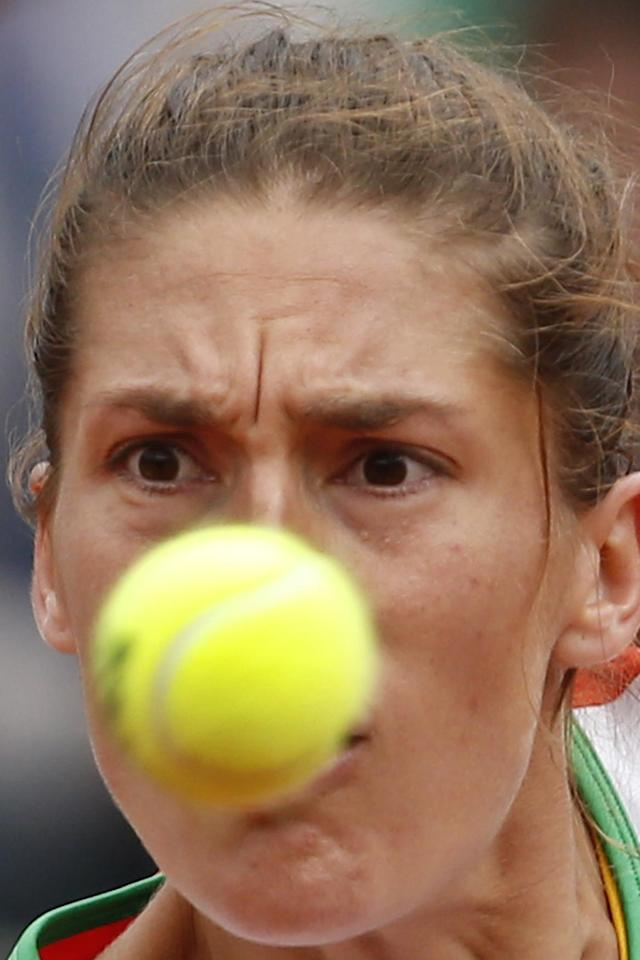 Germany's Andrea Petkovic returns the ball during the quarterfinal match of the French Open tennis tournament against Italy's Sara Errani at the Roland Garros stadium, in Paris, France, Wednesday, June 4, 2014. (AP Photo/Darko Vojinovic)