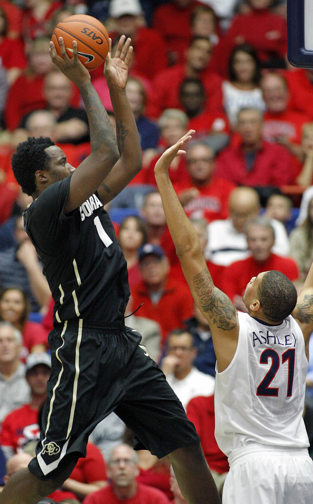 Colorado's Wesley Gordon (1) shoots for two over the arms of Arizona's Brandon Ashley (21) in the first half of an NCAA college basketball game, Thursday, Jan. 23, 2014 in Tucson, Ariz. (AP Photo/John Miller)