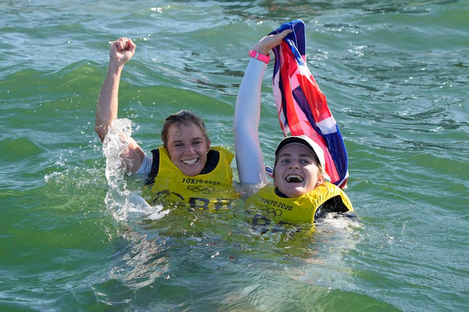 Hannah Mills and Eilidh McIntyre celebrate after winning the women's 470 race (Gregorio Borgia/AP)