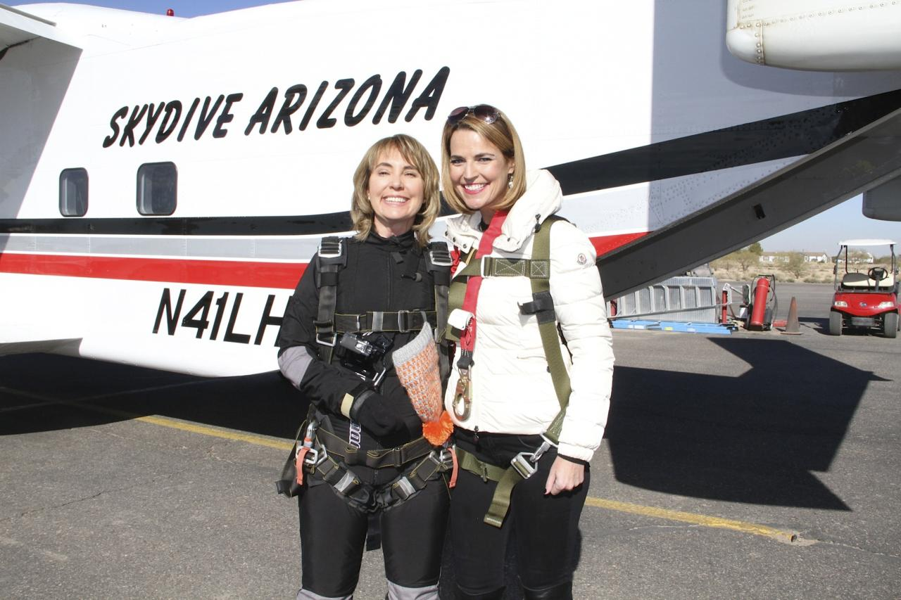 Former U.S. Congresswoman Gabrielle Giffords (L) is pictured with Savannah Guthrie of NBC's TODAY show in this handout photo from Gifford's skydive released by NBC's TODAY show on January 8, 2014. Guthrie joined Giffords as she skydived for a report and interview to air exclusively on NBC's TODAY. Giffords, who is still recovering from a shooting rampage that left the Arizona Democrat badly wounded with a gunshot to the head, went skydiving on Wednesday to mark the third anniversary of the attack, according to an NBC journalist who accompanied her. REUTERS/NBC's TODAY show/Handout via Reuters (UNITED STATES - Tags: POLITICS PROFILE MEDIA) ATTENTION EDITORS - NO SALES. NO ARCHIVES. THIS IMAGE WAS PROVIDED BY A THIRD PARTY. FOR EDITORIAL USE ONLY. NOT FOR SALE FOR MARKETING OR ADVERTISING. THIS PICTURE IS DISTRIBUTED EXACTLY AS RECEIVED BY REUTERS, AS A SERVICE TO CLIENTS. MANDATORY CREDIT