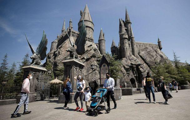 FILE PHOTO: Guests walk through Hogwarts Castle within the grounds of The Wizarding World of Harry Potter on the re-opening of Universal Studios Hollywood during the COVID-19 outbreak in Universal City, California, April 15, 2021. Mario Anzuoni / Reuters)