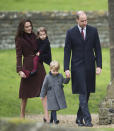 <p>In 2016, the Cambridges co-ordinated in shades of burgundy, navy and grey. Kate wore a burgundy Hobbs 'Celeste coat,' adding a faux fur collar. She accessorised with her Tod's fringed pumps, her Mulberry 'Bayswater' clutch and pearl earrings. (PA) </p>