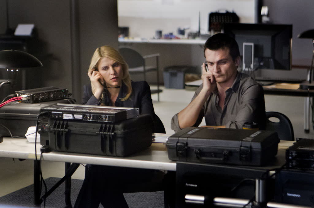 "Claire Danes as Carrie Mathison and Rupert Friend as Peter Quinn in the ""Homeland"" Season 2 episode, ""New Car Smell."""