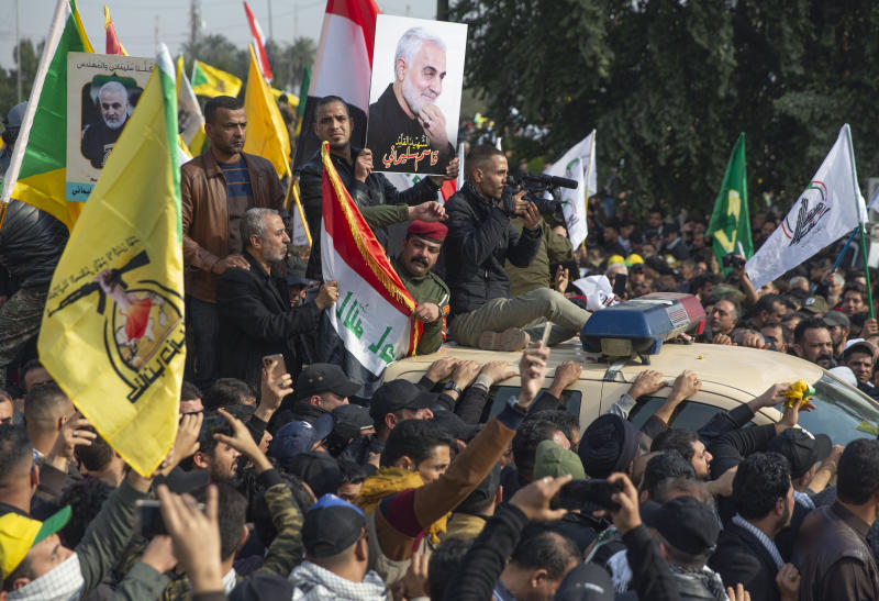 "Mourners march during the funeral of Iran's top general Qassem Soleimani, and Abu Mahdi al-Muhandis, deputy commander of Iran-backed militias in Iraq known as the Popular Mobilization Forces, in Baghdad, Iraq, Saturday, Jan. 4, 2020. Thousands of mourners chanting ""America is the Great Satan"" marched in a funeral procession Saturday through Baghdad for Iran's top general and Iraqi militant leaders, who were killed in a U.S. airstrike. (AP Photo/Nasser Nasser)"