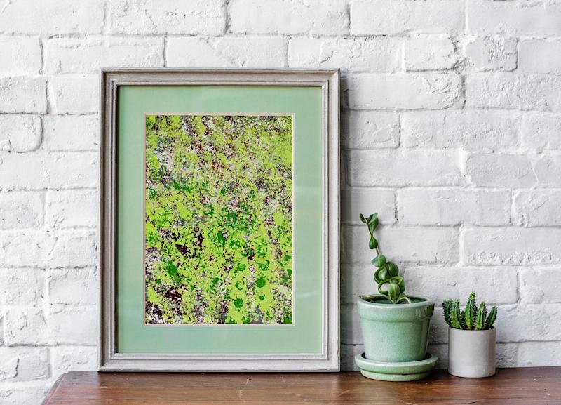 One of the pieces pictured in a frame with a green background. Source: Facebook/Lawson Smith Art